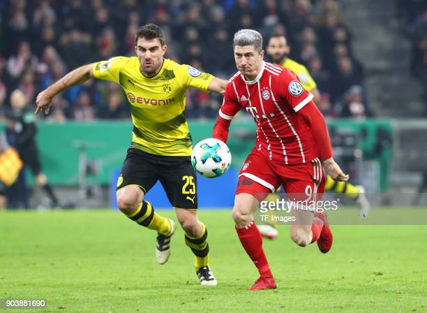 Sokratis Papastathopoulos of Dortmund and Robert Lewandowski of Muenchen battle for the ball during the DFB Cup match between Bayern Muenchen and...