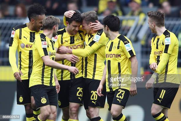 Sokratis Papastathopoulos of Dortmund celebrates his team's second goal with team mates during the Bundesliga match between Borussia Dortmund and...