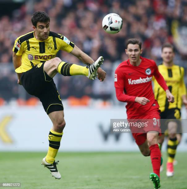 Sokratis Papastathopoulos of Dortmund clears the ball during the Bundesliga match between Borussia Dortmund and Eintracht Frankfurt at Signal Iduna...