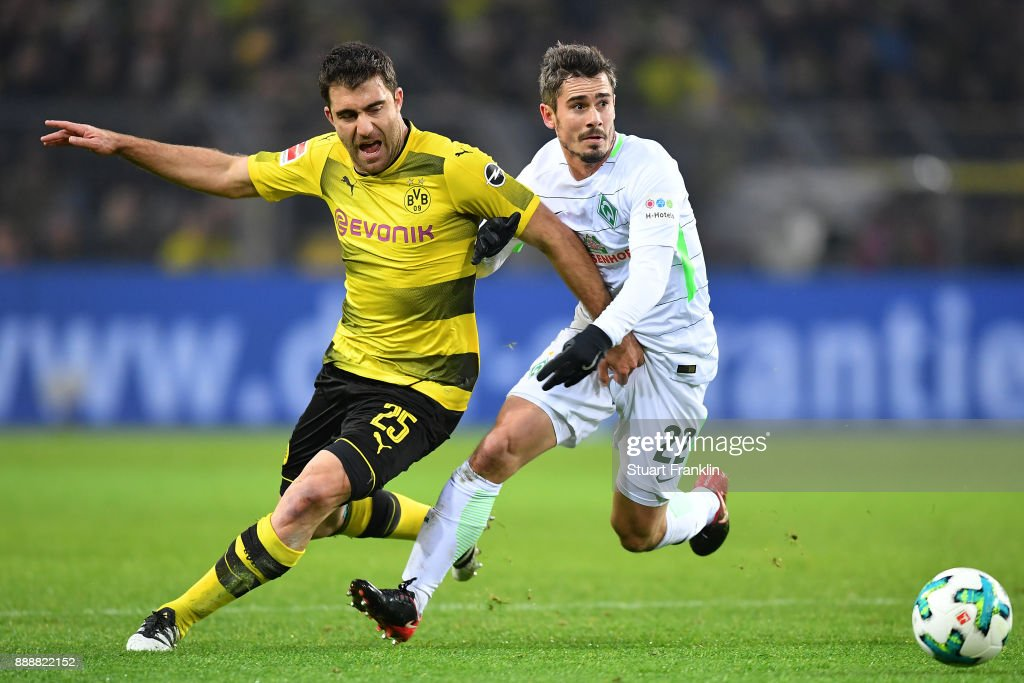 Sokratis Papastathopoulos of Dortmund (l) fights for the ball with Fin Bartels of Bremen during the Bundesliga match between Borussia Dortmund and SV Werder Bremen at Signal Iduna Park on December 9, 2017 in Dortmund, Germany.