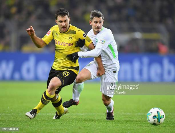 Sokratis Papastathopoulos of Dortmund is challenged by Fin Bartels of Bremen during the Bundesliga match between Borussia Dortmund and SV Werder...