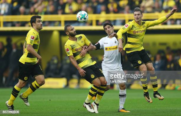 Sokratis Papastathopoulos of Dortmund Oemer Toprak of Dortmund Lars Stindl of Moenchengladbach and Lukasz Piszczek of Dortmund fight for the ball...