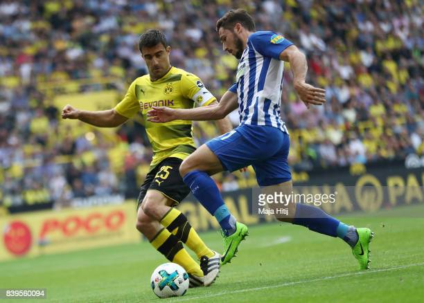 Sokratis Papastathopoulos of Dortmund with Mathew Leckie of Berlin during the Bundesliga match between Borussia Dortmund and Hertha BSC at Signal...