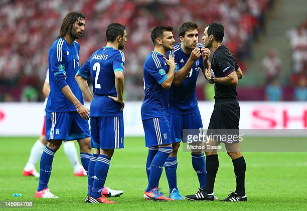 Sokratis Papastathopoulos of Greece appeals to the Referee Carlos Velasco Carballo before he is sent off after receiving a second yellow card during...