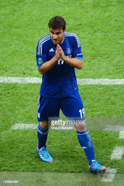 Sokratis Papastathopoulos of Greece gestures as he is sent off during the UEFA EURO 2012 group A match between Poland and Greece at The National...