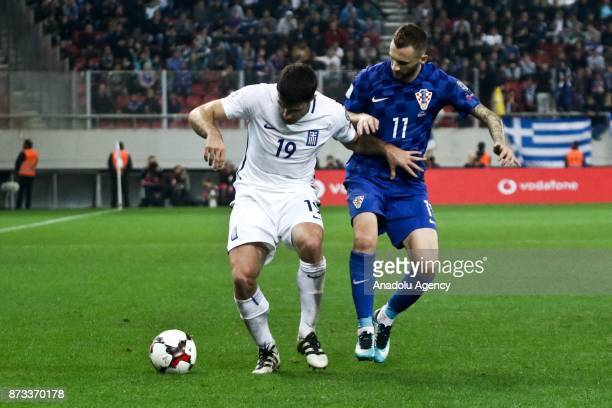 Sokratis Papastathopoulos of Greece in action against Marcelo Brozovic of Croatia during the World Cup Russia 2018 European Qualifiers match between...