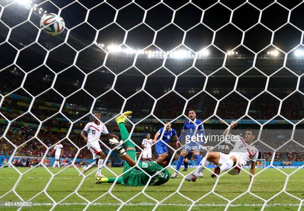 Sokratis Papastathopoulos of Greece scores his team's first goal past Keylor Navas of Costa Rica during the 2014 FIFA World Cup Brazil Round of 16...