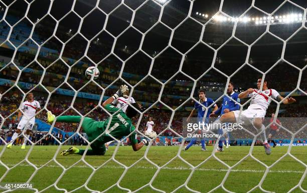 Sokratis Papastathopoulos of Greece shoots and scores his team's first goal past goalkeeper Keylor Navas of Costa Rica during the 2014 FIFA World Cup...