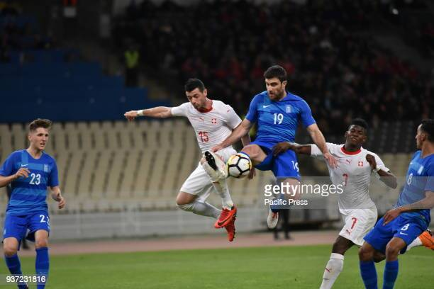 STADIUM ATHENS ATTIKI GREECE Sokratis Papastathopoulos of Greece stops in the attack of Breel Embolo and of Blerim Dzemaili of Switzerland...