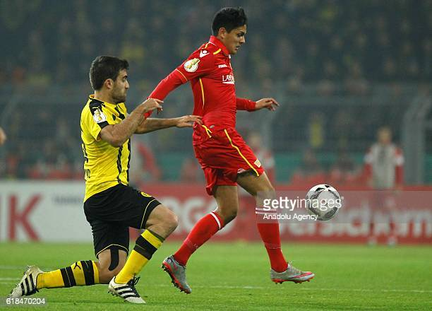 Sokratis PapastathopoulosL of Borussia Dortmund in action with Eroll Zejnullahu of 1FC Union Berlin during the DFB Pokal soccer match between...