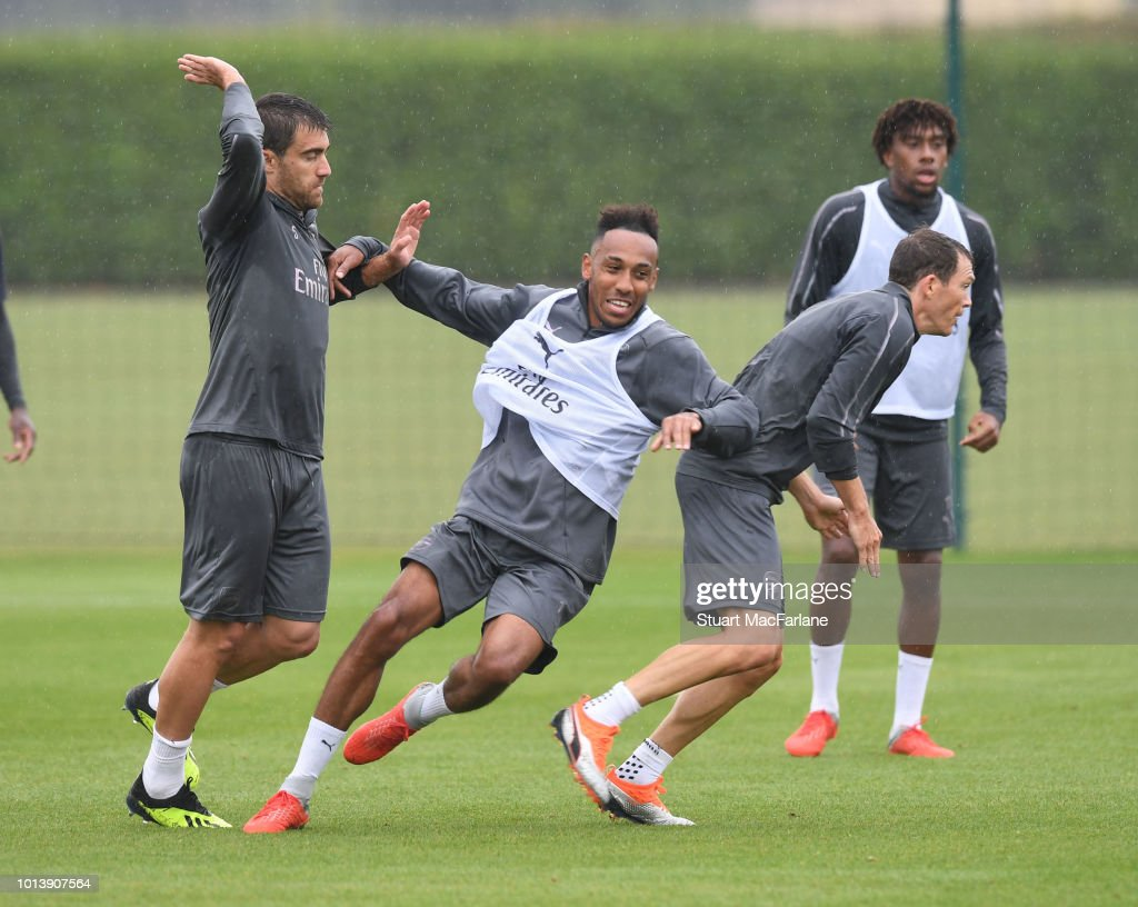 Sokratis, Pierre-Emerick Aubameyang and Stephan Lichtsteiner of Arsenal during a training session at London Colney on August 10, 2018 in St Albans, England.