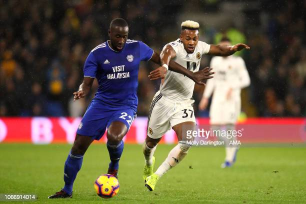 Sol Bamba of Cardiff City and Adama Traore of Wolverhampton Wanderers during the Premier League match between Cardiff City and Wolverhampton...