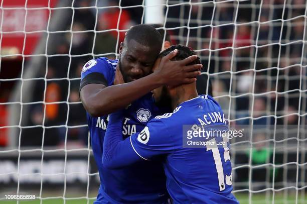 Sol Bamba of Cardiff City celebrates with teammate Leandro Bacuna after scoring his team's first goal during the Premier League match between...