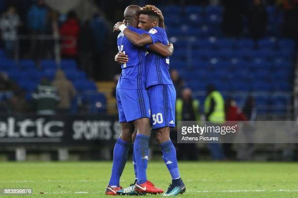 Sol Bamba of Cardiff City embraces Omar Bogle of Cardiff City after the final whistle of the Sky Bet Championship match between Cardiff City and...