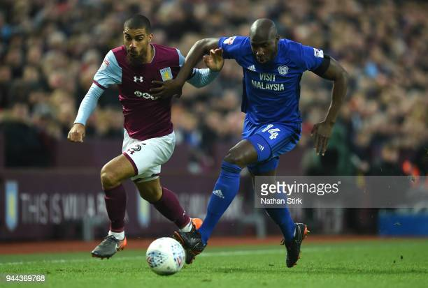 Sol Bamba of Cardiff City is challenged by Lewis Grabban of Aston Villa during the Sky Bet Championship match between Aston Villa and Cardiff City at...