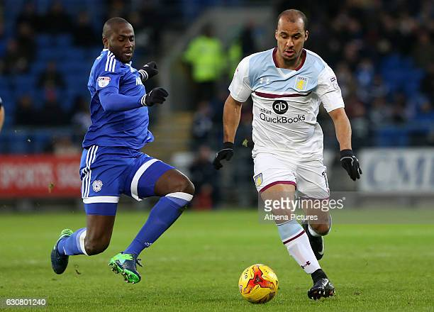 Sol Bamba of Cardiff City is challenges Gabriel Agbonlahor of Aston Villa during the Sky Bet Championship match between Cardiff City and Aston Villa...