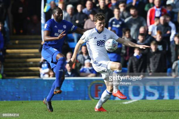 Sol Bamba of Cardiff City marks Sam Gallagher of Birmingham City during the Sky Bet Championship match between Cardiff City and Birmingham City at...