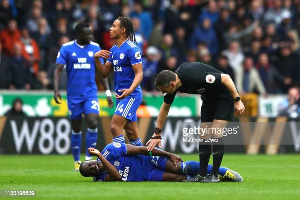 Sol Bamba of Cardiff City reacts after a challenge from Adama Traore of Wolverhampton Wanderers during the Premier League match between Wolverhampton...
