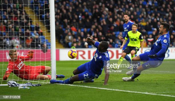 Sol Bamba of Cardiff City scores but it is disallowed during the Premier League match between Cardiff City and Huddersfield Town at Cardiff City...