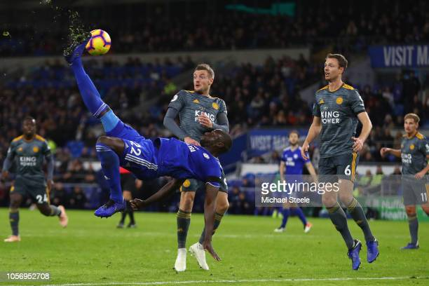 Sol Bamba of Cardiff City shoots wide with a overhead kick narrowly wide as Jamie Vardy and Jonny Evans of Leicester City look on during the Premier...