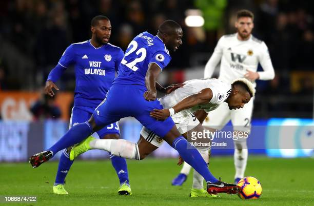 Sol Bamba of Cardiff City tackles Adama Traore of Wolverhampton Wanderers during the Premier League match between Cardiff City and Wolverhampton...