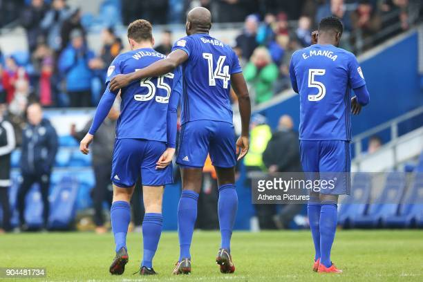 Sol Bamba of Cardiff City wraps his arm around Yanic Wildschut after the final whistle of the Sky Bet Championship match between Cardiff City and...