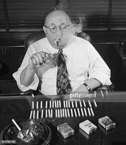 Sol C Korn cigarette authority puffs prodigiously as he makes the final and severest test of a cigarette the smoking It's just a job to him