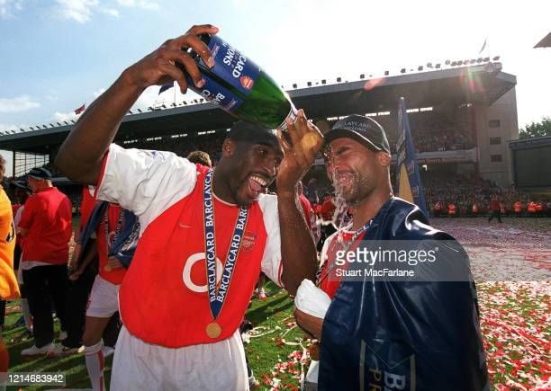 Sol Campbell and Ashley Cole of Arsenal celebrate after the Premier League match between Arsenal and Leicester City on May 15 2004 in London England