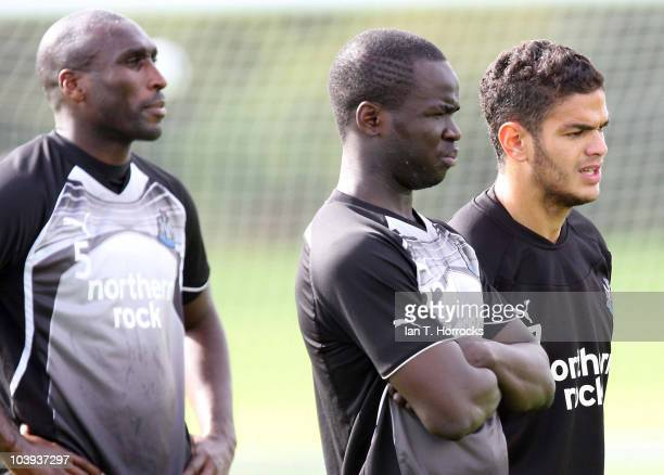 Sol Campbell Hatem Ben Arfa and Cheik Tiote look on during a Newcastle United training session at the Little Benton Training Ground on September 09...