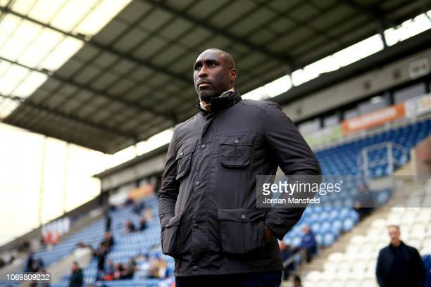 Sol Campbell Manager of Macclesfield Town looks on prior to the Sky Bet League Two match between Colchester United and Macclesfield Town at...