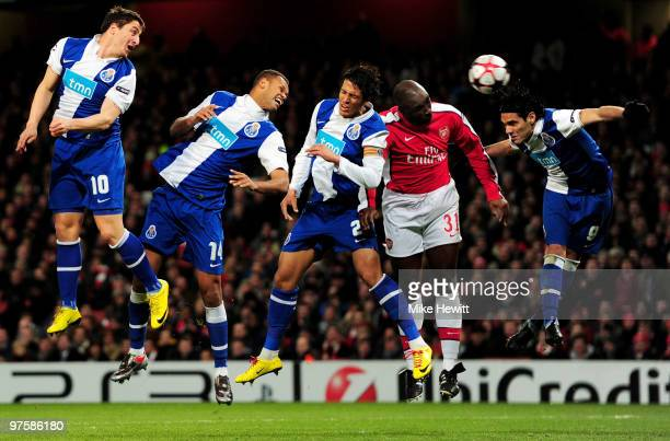 Sol Campbell of Arsenal beats the Porto defence to direct a header on goal during the UEFA Champions League round of 16 match between Arsenal and FC...
