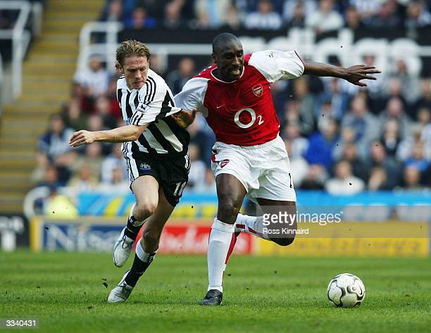 Sol Campbell of Arsenal holds off Craig Bellamy of Newcastle during the FA Barclaycard Premiership match between Newcastle United and Arsenal at St...