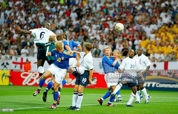 Sol Campbell of England scores the first goal in the first during the England v Sweden Group F World Cup Group Stage match played at the Saitama...