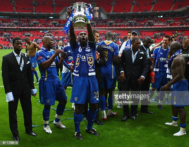 Sol Campbell of Portsmouth lifts the trophy following the FA Cup Final sponsored by EON between Portsmouth and Cardiff City at Wembley Stadium on May...