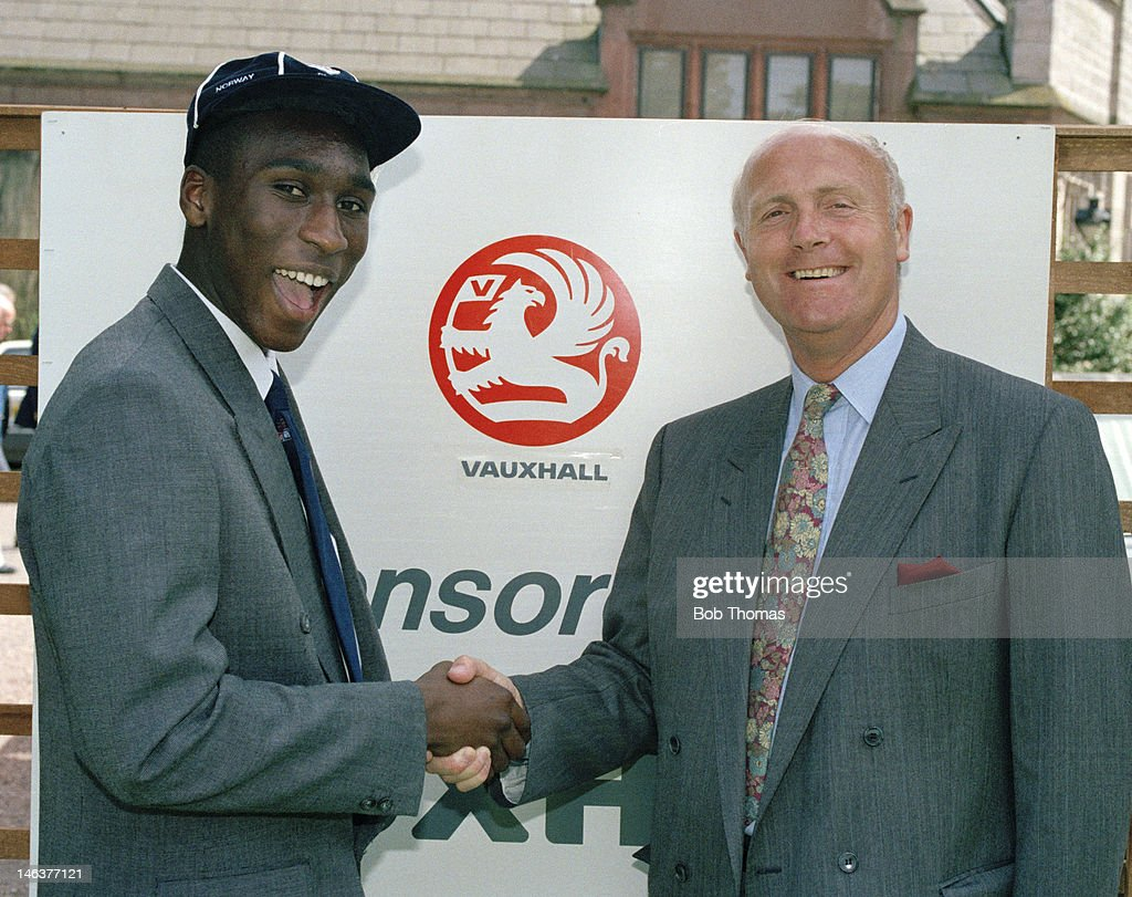 Sol Campbell (left) receives his England Schoolboy's Cap from England assistant coach Don Howe during the graduation ceremony at the National Sports Centre in Lilleshall, 9th July 1991.