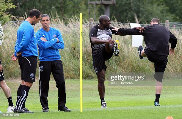 Sol Campbell trains with Kevin Nolan as manager Chris Hughton watches on during a Newcastle United training session at The Little Benton training...