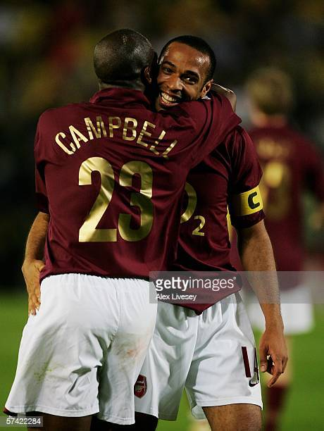 Sol Capmbell and Thierry Henry of Arsenal celebrate after the final whistle during the Champions League Semi Final Second Leg match between...
