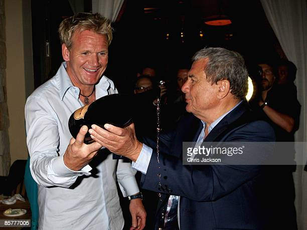 Sol Kerzner and Gordon Ramsay take part in the 'Sabre Ceremony' at Maze restaurant during the Grand Opening of the new OneOnly Cape Town resort on...