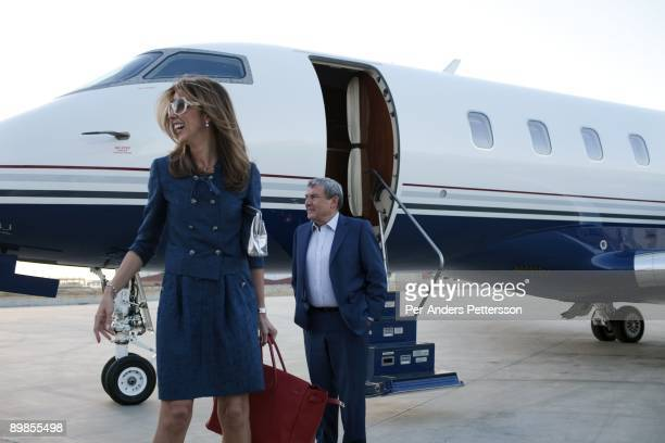 Sol Kerzner the South African hotel magnate stands outside his private plane with his wife Heather after arriving from Johannesburg on April 1 2009...