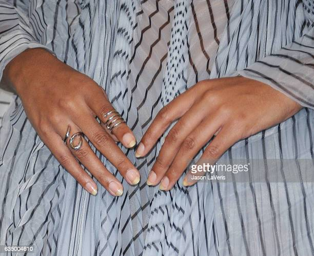 Solange Knowles jewelry detail poses in the press room at the 59th GRAMMY Awards at Staples Center on February 12 2017 in Los Angeles California