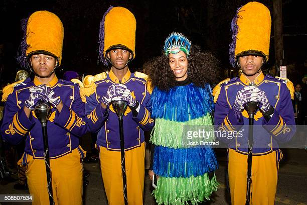 Solange Knowles wearing a dress by Jeremy Scott poses with members of the St Augustine High School Marching Band at the 2016 Muses parade on February...