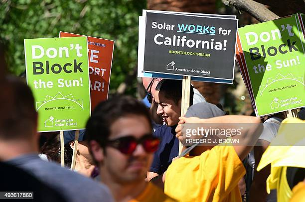 Solar advocates hold a rally to challenge Southern California Edison's proposal to cripple rooftop solar energy in Los Angeles California on October...