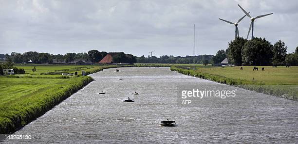 Solar boats pass Harlingen and Franeker during the Dong Energy Solar Challenge held in Leeuwarden the Netherlands on July 13 2012 The solar boats...