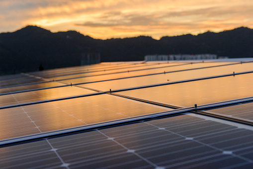 Solar cell panel with sunset - gettyimageskorea