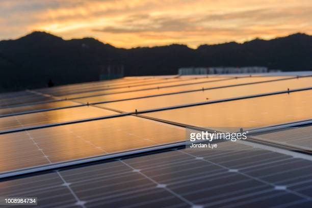solar cell panel with sunset - solar powered station stock pictures, royalty-free photos & images