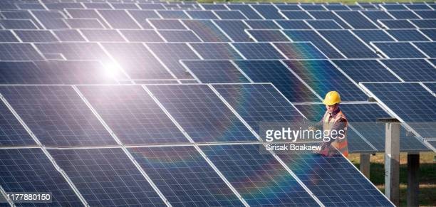 solar cell power engineer technician - solar powered station stock pictures, royalty-free photos & images