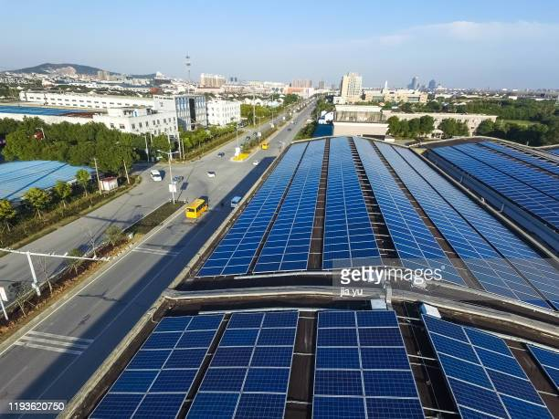 solar cells for aerial photos of roofs - 江陰市 ストックフォトと画像