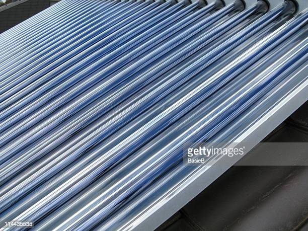 solar cells on a roof - solar energy dish stock pictures, royalty-free photos & images
