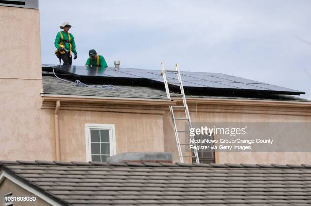 BEACH Solar City installers Tony Farias left Cody Corbett and Julian White left place the final panel on Bruce Lemmon's roof in Long Beach CA on...