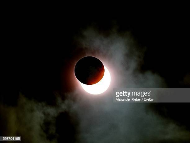 Solar Eclipse In Cloudy Sky